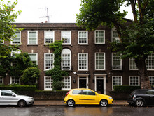 Yellow Car Parked Near An English House