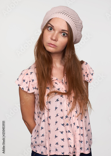 puzzled young woman staring at camera Canvas Print