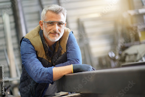 Portrait of middle-aged ironworker in workshop Wallpaper Mural