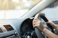 Woman Hand Holding Control Steering Wheel Driving Car Road Trips Travel In The Morning Day