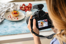 Female Food Photographer Worki...