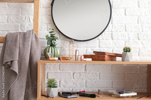 Fototapety, obrazy: Dressing table with set of cosmetics near white brick wall