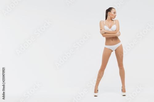 Beautiful sporty woman body. Sexy female slim tanned girl