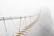 Hanging bridge in fog