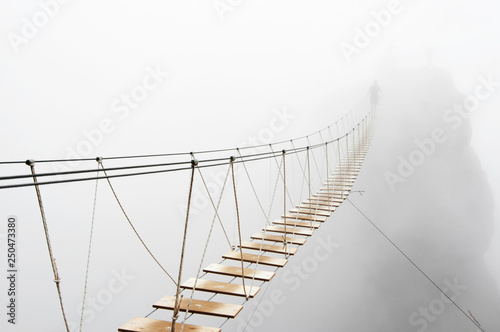 Hanging bridge in fog