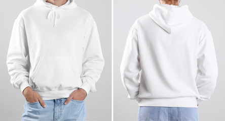 Man in blank hoodie sweater on light background, closeup. Mock up for desing
