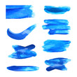 Set with abstract brushstrokes of blue paint on white background, top view