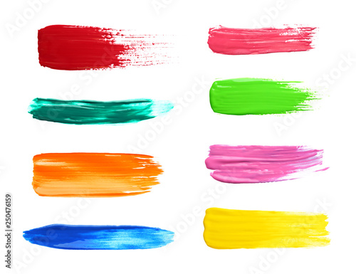 Photo Set with abstract brushstrokes of different bright paints on white background, t