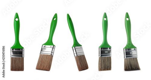 Photo Set of clean paint brushes on white background