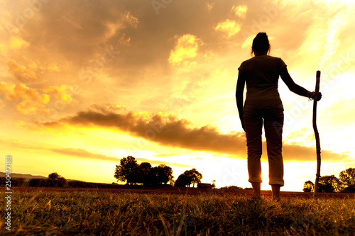 Pilgrim woman at Sunset