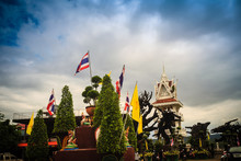 Beautiful Bell Tower And Thai Flags With White Clouds And Blue Sky Background At Wat Tham Khuha Sawan, Khong Chiam, Ubon Ratchathani, Thailand.