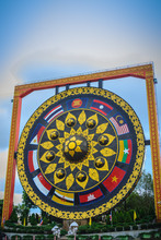 Beautiful Buddhist Giant Gong With Southeast Asian Flags Painted At Wat Tham Khuha Sawan Temple, Khong Chiam District, Ubon Ratchathani Province,Thailand.