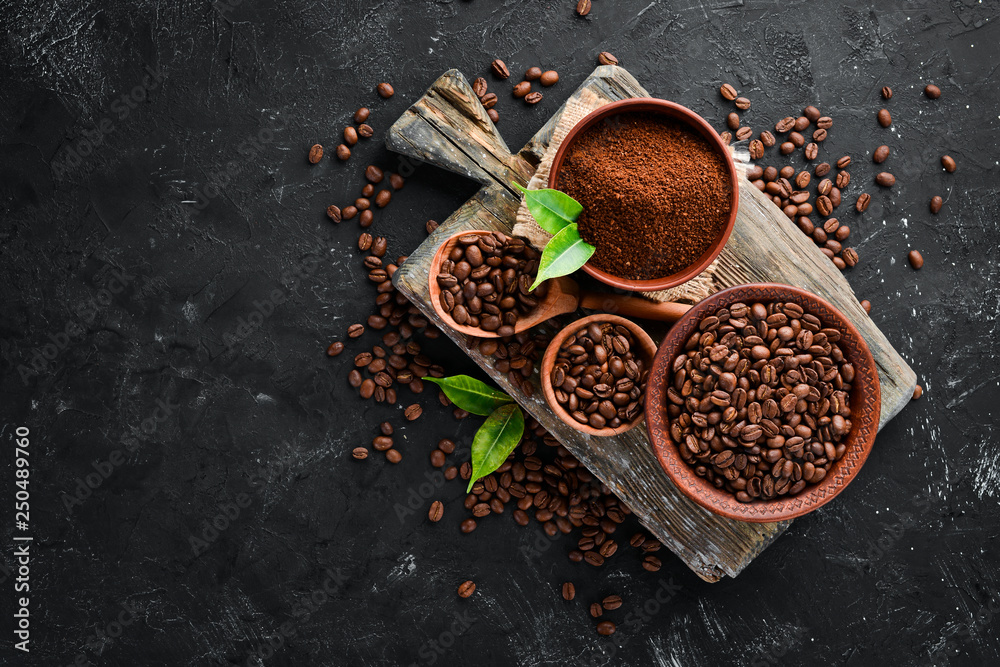 Fototapety, obrazy: Ground coffee and coffee beans. Assortment of coffee varieties on a black background. Top view. Free space for your text.