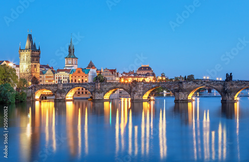 Poster Prague Scenic view on Vltava rive, Charles bridge and historical center of Prague, buildings and landmarks of old town at sunset, Prague, Czech Republic