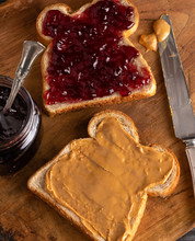 Peanut Butter And Jelly Sandwich On A Wooden Kitchen Counter