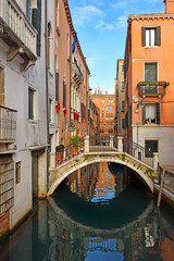 romantic cityscape of old Venice with a bridge over the canal, Italy