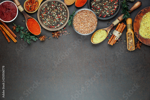Obraz Spices and seasonings for cooking in the composition on the table - fototapety do salonu