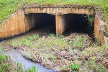 Reinforced Concrete Box Culverts Under The Asphalt Road. Box Culvert Is A Structure That Allows Water To Flow Under A Road, Railroad, Trail, Or Similar Obstruction From One Side To The Other Side.