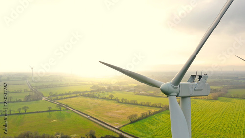 Obraz Aerial photo of wind turbines at sunset in Sainte Pazanne, France - fototapety do salonu