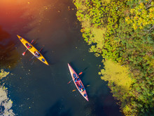 Aerial Drone Bird's Eye View Photo Of Happy Family With Two Kids Enjoying Kayak Ride On Beautiful River. Little Boy And Teenager Girl Kayaking On Hot Summer Day. Water Sport Fun.