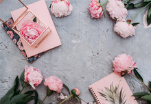 Styled Feminine Flat Lay On Pale Peach Background, Top View.Minimal Woman's Desktop With Blank Page Mock Up And Peony Flower With Petals. Creative Concept, Greeting Card.