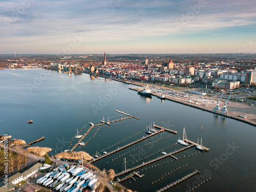 Cuadros en Lienzo port of rostock - aerial view over the river warnow - background city of rostock