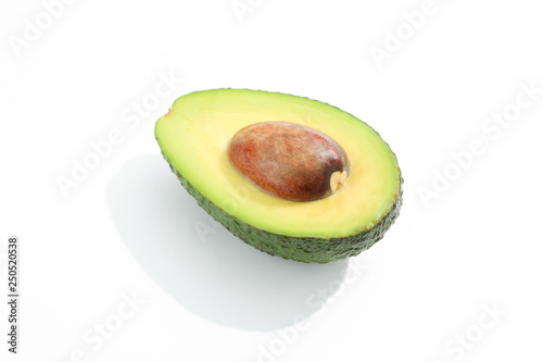 Fotografía  Half of avocado on white background, space for text