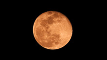 Extreme Zoom Photo Of Redish Full Moon As Seen In Deep Darkness