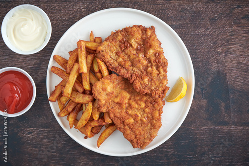 Schnitzel Mit Pommes Ketchup Und Mayonnaise Buy This Stock Photo