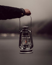 Man's Hand Holding Lantern By ...