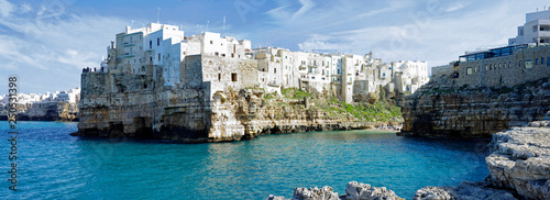 Poster Lama Dramatic view of cliffs with caves rising from Adriatic sea in Polignano a Mare, Puglia, Italy