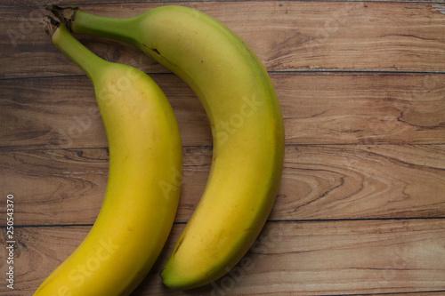 Fototapeta Bananas On Wood Board obraz na płótnie