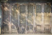 Old Ancient Wooden Swing Door Background. Vintage Of Old Wooden Folding Doors Texture. Antique Swing Doors Or Folding Doors At Old Wooden Commercial Building.