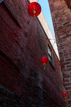 Red Chinese Lanterns Hang In Fan Tan Alley In Chinatown, Victoria, British Columbia, Canada