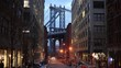 WS Street with Manhattan Bridge in background at dusk / New York City, New York, USA