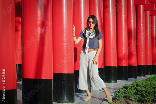 Foto  Woman and beautiful red poles