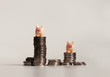 canvas print picture - Two miniature pink piggy on top of pile of coins.