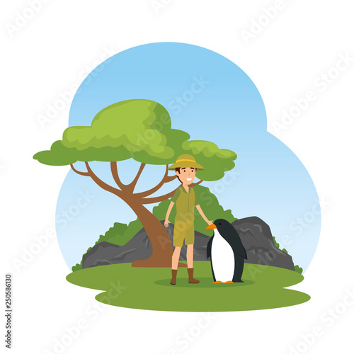 man worker of zoo with penguin in the camp