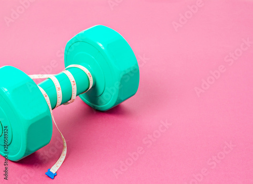 Green dumbbell and measuring tape. Canvas Print