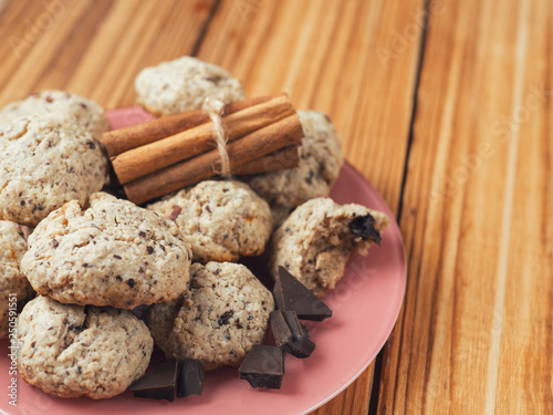 Staande foto Zuivelproducten Homemade oatmeal cookies with dried fruits, nuts, chocolate and cinnamon