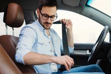 Driver Fastening His Seat Belt...