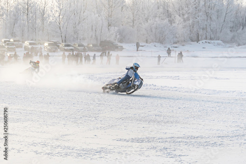 Fotografiet  Winter motocross, Driver with motorcycle