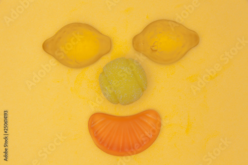 A funny bizarre face made of hard and soft sugar candy