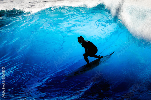 Foto  Silhouette surfer riding the big blue surf waves on the island Madeira, Portugal