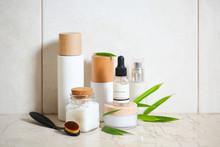 Face Cream, Serum, Lotion, Moisturizer And Sea Salt  Among Bamboo Leaves