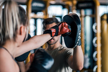 Woman Boxer Hitting The Glove Of Her Sparring Partner, Close-up.
