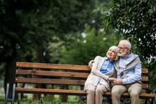 Happy Senior Couple Hugging An...