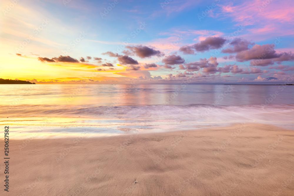 Fototapeta Gentle sunset above ocean, beautiful tropical clouds