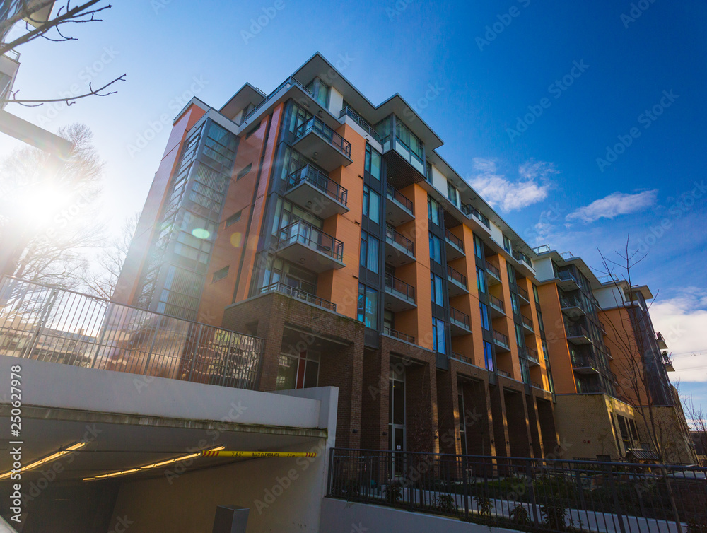 Fototapety, obrazy: Low rise apartment building on sunny day in British Columbia, Canada