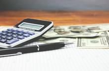 Money And Calculator Calculation